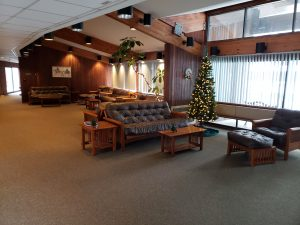 Hemlocks center foyer with windows and seating pictured.